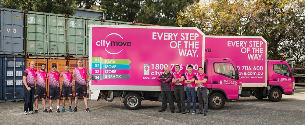 Group shot of removalists in front of Citymove truck in Mascot Sydney