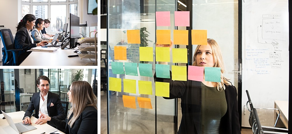 Staff working at computers, woman writing on sticky notes on glass wall
