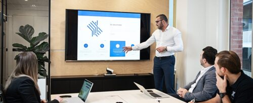 Man presenting in meeting room on TV screen in Sydney