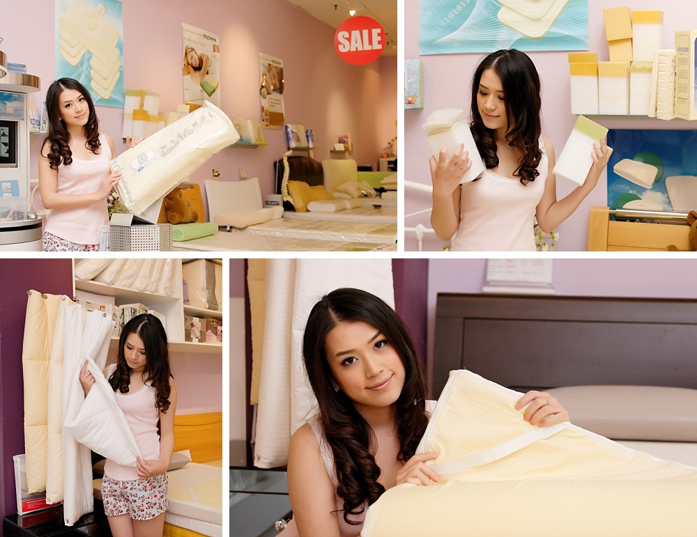 Young woman demonstrating bedding products in sleepwear for Sleepmart Advertising shoot