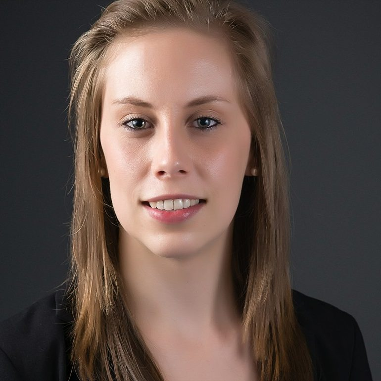 Professional Headshot of young woman in Sydney studio against grey background