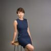 Sydney Professional profile photo of Asian female in blue dress seated on stool in Coogee studio