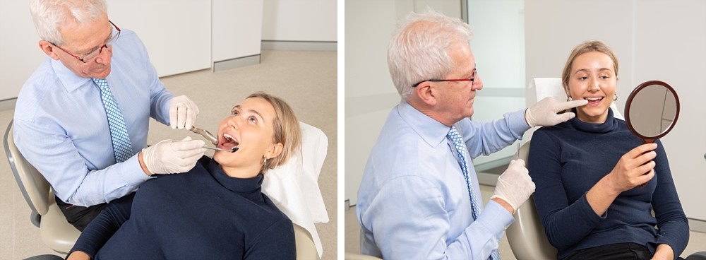 Dentist examining patient in dental chair, pointing out teeth in mirror