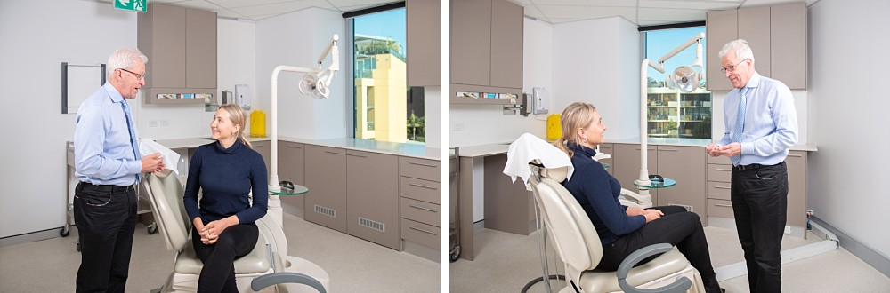Dental patient sitting in dental chair talking to dentist