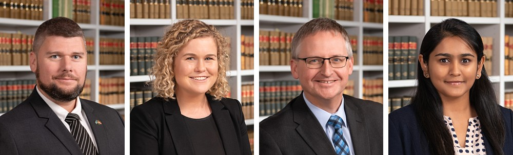 Lawyer headshots in front of bookshelf in Sydney Law Office