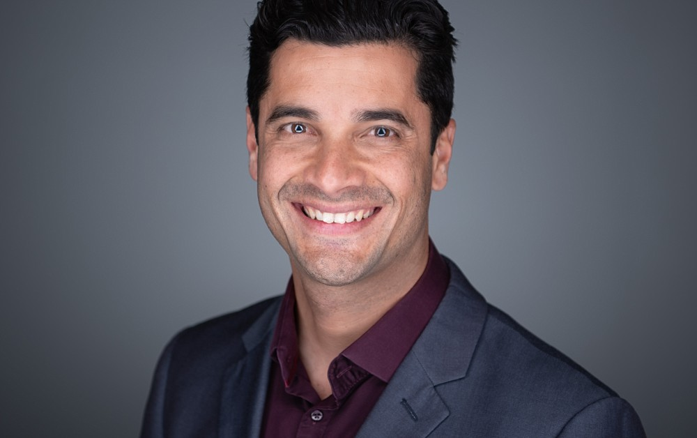 Strong corporate headshot with eye contact and intent, in Sydney studio