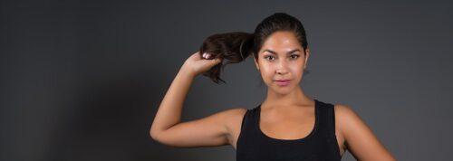 Female actor headshots sporty black singlet and leggings in Sydney studio